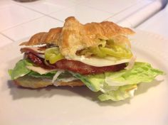 Croissant smoked turkey,bacon,provolone cheese,lettuce,mayo.mustard,submarine dressing and sliced peperoncinis