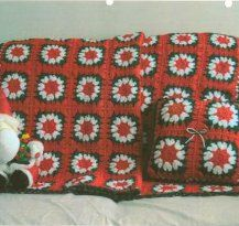 The Holiday Granny Afghan and Pillow will make a wonderful Christmas gift set for someone you love. Red, green, and white yarn makes these g...