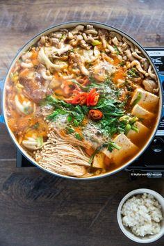 Spicy Korean hot pot with dumplings. It's loaded with super-sized dumplings, kimchi, tofu and mushrooms. Your ultimate comfort hot pot recipe. Korean Dishes, Korean Food, Soup Recipes, Chicken Recipes, Cooking Recipes, Recipe Chicken, Asian Recipes, Healthy Recipes, Ethnic Recipes