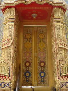 A beautiful and intricate design doorway which reflects the Thai peoples culture and belief.