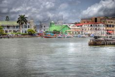 Belize City Harbor in Belize. Even when the tropical western Caribbean sky is grey, the color and style of the local buildings are bright and beautiful. Oh The Places You'll Go, Places To Travel, Travel Destinations, Places To Visit, Honduras, Costa Rica, Rhapsody Of The Seas, Countries In Central America, Belize City