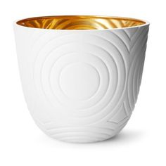 This handmade bisque porcelain bowl which features an intricate concentric circle design, has been hand-painted with 18k gold interior finish to create a stunning decorative accent | domino.com