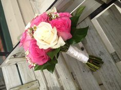 i love the simple elegance of this, pink and white rose bouquet accented with wax flower.