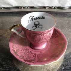 Poison Tea Cup and Saucer Pink and Gold Arsenic Gothic Antique altered china Chase and Scout - 38.00 etsy by Desiree Ruth Hagedorn
