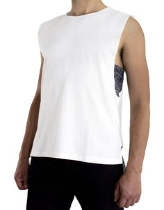 Tank top. Wide arm holes, dark navy details on sides and back hem.