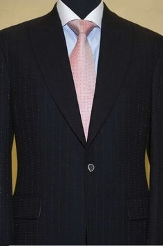 Most expensive suit...vicuña wool, threaded with 18-karat gold ...