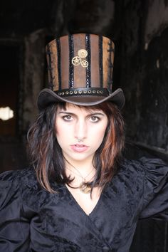 This model wearing the Rivet by Steampunk Hatter truly an eye catching hat!