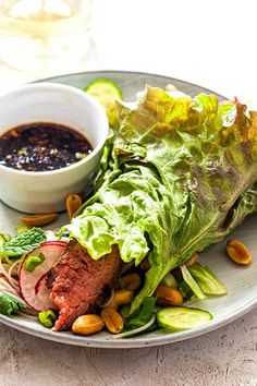 Asian Beef Lettuce Wraps! Try this easy Asian-inspired take on lettuce wraps with grilled beef, crisp vegetables, and fresh herbs. The spicy marinade of Sriracha, ginger, lime, and fish sauce doubles as a dipping sauce! #simplyrecipes #lettucewrap #steak #lowcarb #healthydinnerideas Steak Wraps, Beef Lettuce Wraps, Lettuce Wrap Recipes, Grilling Recipes, Beef Recipes, Whole Food Recipes, Dinner Recipes, Easy Delicious Recipes, Healthy Eating Recipes