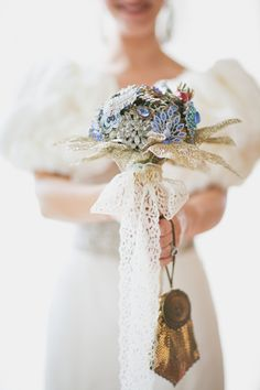 love the cotton lace and glittery foliage tucked in the bouquet