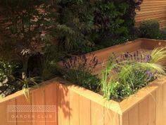 small garden seating design.  Raised zig-zag beds for definition, path