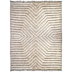 Hand-Knotted - Stella Rug - I love mixing a geometric rug with other patterns that are more painterly or organic. I would use this in combination with solid upholstery options on the chairs/daybed and a mix of fun accent pillows.
