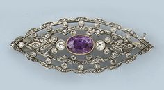 An openwork navette shaped rubellite and diamond brooch, circa 1920