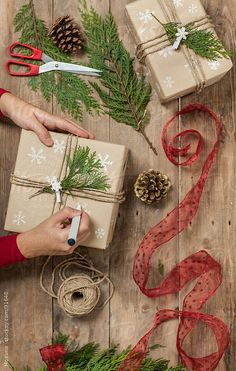 hand-drawn snowflakes, kraft (wrapping) paper, triple wrapped twine & evergreen sprig #giftwrap