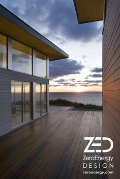 Ocean view deck at sustainable beach house on Cape Cod by green architect ZeroEnergy Design.  www.zeroenergy.com