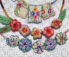 Art Spirit: On our way to France and the Netherlands.little necklace pendants made with vintage linens gypsy boho vintage chic floral accessories Fabric Beads, Fabric Art, Fabric Crafts, Sewing Crafts, Sewing Projects, Embroidery Transfers, Embroidery Patterns, Hand Embroidery, Embroidery Stitches