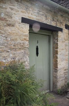 pale stone (Cotwolds or Ancaster) and green doors - Card Room Green from Farrow and Ball is my favourite - Arlington Rowe in Bibury - http://ifoundmyhome.blogspot.co.uk/