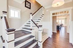 White Staircase with Stained Stairs & Railing with Small Window