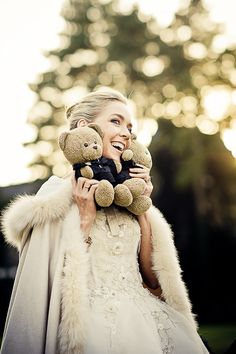 Winter wedding dress with cape, love the cape idea and of course the teddy bear