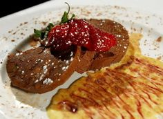 """Chocolate Fondant, laced with bits of orange peel, a heavenly ganachelike dessert at Le Bistro du Beaujolais, 8134 Columbia Road, Olmsted Falls, 440-235-8883. The historic 1830s farmhouse that's home Le Bistro brims with charm, heightened by the French Provencal dishes that populate its menu. There's nothing """"haute"""" about this cozy little boite, unless your perception (or rather, misconceptions) of the cuisine of France mistakenly veers toward snobbery. -- Joe Crea"""