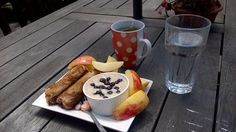 French toast roll ups with cream cheese and blueberries, paired with blueberry and banana oatmeal, apples, vitamins and green tea  amazing breakfast!