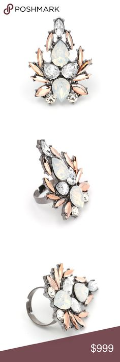 """Coming Soon!! Silver Crystal Topaz Statement Ring Coming Soon!! (Price available upon arrival). Brand new in original packaging!  This stunning adjustable cocktail ring is a statement piece of its own! Bringing sparkle, class, and some punk rock sass this ring features a resizable / adjustable silver tone band, & clear, white, peachy orange topaz gold crystals set in antique silver zinc alloy.  marquise, pear, round, briolette cut shapes give brilliant hues of color! """"Like"""" to be notified of…"""