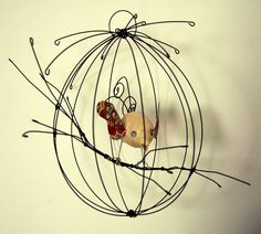 bird cage in wire and paper