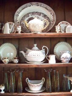 Antique Brown and White;  Greeson's collection  of porcelain, English hotel silver and modern glasses over bar in 18 century cabinet. Blowing Rock.