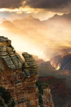 A mist of rain illuminated by the setting sun in the Grand Canyon; photo by Adam Schallau