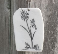 Large Black and White Two Flowers Drawing on Polymer Clay Pendant. $19.50, via Etsy.