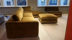 """Custom 6 piece sectional, with 3/4"""" white oak reveal stained grey."""