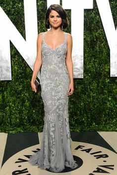 Selena Gomez took a sophisticated turn at the 2012 Vanity Fair Oscar party in a silver embroidered gown.   Brand: Dolce & Gabbana