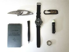 EDC  submitted by Unkn0wn  CRKT 5102N  True Utility FIXR  Titanium Ring  Jass All Weather Notebook  UltraTac K18  Maxpediton Tactical Pen With Fisher Space Pen Refill  Citizen Divers Eco-Drive Watches