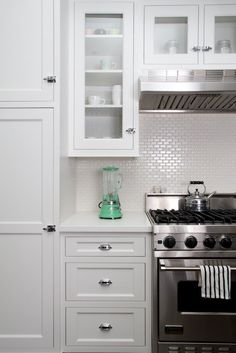 Cute blender + cabinet & drawer hardware + white tile splashback