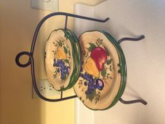 My goodwill find! A plate holder for 1.99! I love thrift shopping! Contemplating draping grapes on it for my wine themed kitchen!