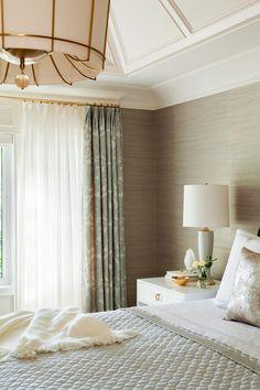 grasscloth wallpaper, brass curtain rods, statement chandelier, soothing neutrals