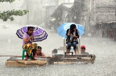 Philippines - From Monsoon Rain Floods Manila, one of 31 photos. Here, residents ride on a makeshift raft during a heavy downpour along a flooded street in Malabon, Metro Manila, on August Rain Umbrella, Under My Umbrella, Manila, Monsoon Rain, Smell Of Rain, No Rain, Pictures Of The Week, Dancing In The Rain, Photojournalism