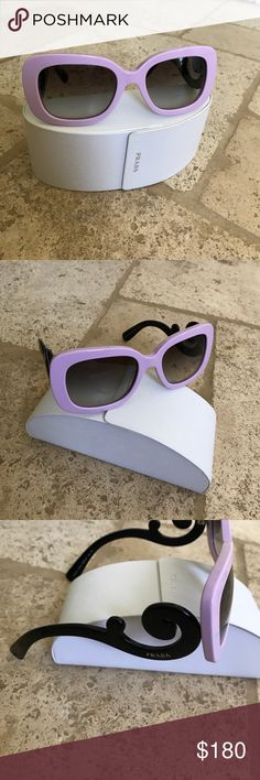 Genuine Prada Sunglasses Pink and black with signature scroll sides. So chic!  No scratches original case included. Original owner and purchaser. Prada Accessories Glasses