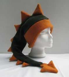 Dark Green / Orange Fleece Dinosaur Mens Boys Hat by Ningen Headwear …Would translate well to pony hatI made one all by myself, with scraps of fleece and no pattern.Sooo it's my new snowboarding beanie I have to make this for my grandson Fabric Crafts, Sewing Crafts, Sewing Projects, Sewing Patterns, Crochet Patterns, Dress Patterns, Knitted Hats, Crochet Hats, Fleece Projects