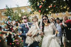 Colourful kitsch confetti shot. A Fabulous Vintage Bride and her Kitsch and Colourful 1960's Inspired Brighton Wedding | Love My Dress® UK Wedding Blog