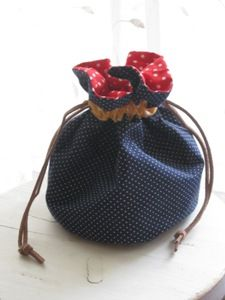Round drawstring bag. love the varying polka dots and colors!