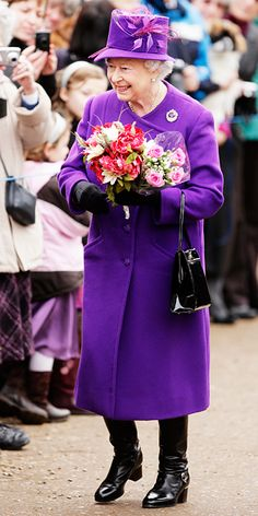 The Queen showed her royalty in a royal purple coat to attend a church service for the 59th anniversary of her accession to the throne.