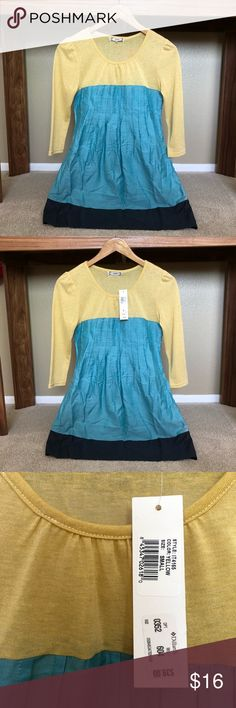 NWT color block tunic size Small Cute NWT tunic originally purchased from Dillard's.  Size small.  Selling because I am breastfeeding and need a bit more room in the bust area at this time!  Color is a subdued yellow, teal, & dark navy at the bottom.   Will accept reasonable offers and am happy to discount for bundles!  Thanks for looking! Tops Tunics Breastfeeding, Dillards, Color Blocking, Room, Tunics, Teal, Happy, Yellow, Dark