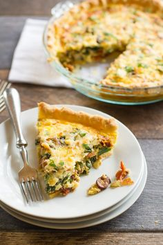 This healthy vegetarian Mediterranean Quiche recipe is packed full of bright flavor and healthy veggies. Serve it for breakfast, brunch, lunch or dinner!