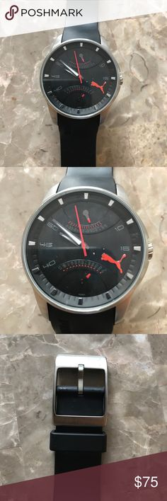 Puma Watch with Rubber Band The face is silver with black/dark grey on the inside & it has a black rubber band.  Great comfortable, sporty Watch.  The battery is dead and I DO NOT have a case for it Puma Accessories Watches