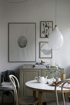 Scandinavian style dining room with decor and interior in beige, gallery wall