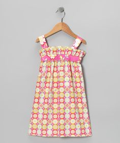 Classic style and heirloom quality characterize this fabulous frock. The terrific back tie waist, ruffle neckline and Made-in-the-USA cotton construction combine for a perfectly pretty and practical look.100% cottonMachine washMade in the USA