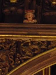 'eavesdroppers'; Hampton Court great hall - In Henry Vlll times, when Henry rebuilt the hall for Anne Boleyn, these were carved high up in the ceiling eaves of the great hall: little figures looking down; it's where we get the saying 'eavesdropper'.