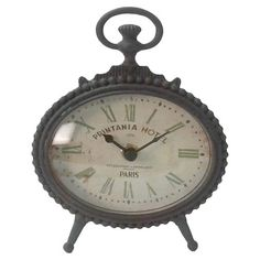 Antique-inspired table clock with Roman numerals.
