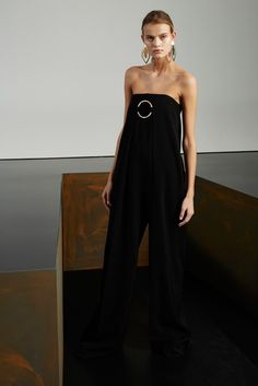 #Black banded jumpsuit with Gold Ring#StellaMcCartney. We would wear this all year long.  With a leather jacket, or a fur shawl, Fabulosity at its finest. Pre-Fall 2015