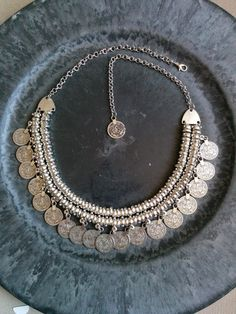 This Gypsy coin necklace is a beautiful statement piece! The necklace closes in the back with a lobster clasp and features an extension chain, with a